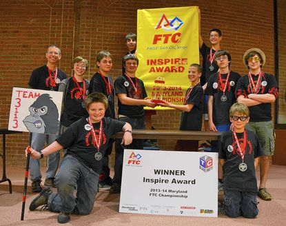 Boy Scout Troop 793's FIRST Robotics FTC Team Some Disassembly Required are seen with their award from the Maryland FTC State Championship. In back holding the banner, left to right, are: Justin Argauer and Zack Gronlund. Second row: Coach Al Gronlund, Mac Smith, Logan Carter, Bradley Argauer, Griffin Holt, James Parry and Connor Tinker. Front row: Ryan Argauer and Jerome Romano.