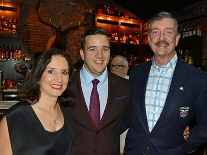 Alex Smith, Atlas Restaurant Group owner, center, with his parents, Vanessa Paterakis Smith, left, and Fred Smith, right, at the Atlas Restaurant Group's VIP Opening Party of Tagliata and The Elk Room, July 29, 2017 (Photo courtesy Baltimore Snap, www.baltimoresnap.com).
