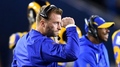 Rams head coach Sean McVay celebrates a touchdown by running back Todd Gurley against the Cowboys at the Coliseum on Jan. 12, 2019.