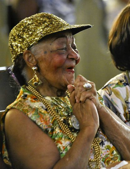 Lucille Marcus Brooks enjoys the music and festivities in her honor at Union Baptist Church in Baltimore, where her 100th birthday celebration was held Saturday.