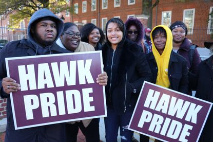 Vernon Johnson, left, a sophomore at the University of Maryland Eastern Shore, holds a sign at a rally in Annapolis with other students last year in support of efforts to settle a federal lawsuit that is more than a decade old involving the state's four historically black colleges.