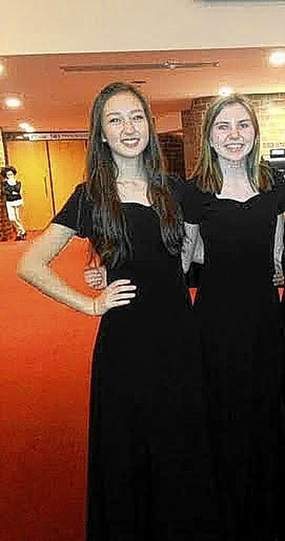 Two Reservoir High School music program students, Kayla Krammes, left, and Myla Wilson, performed with the Baltimore Symphony Orchestra.