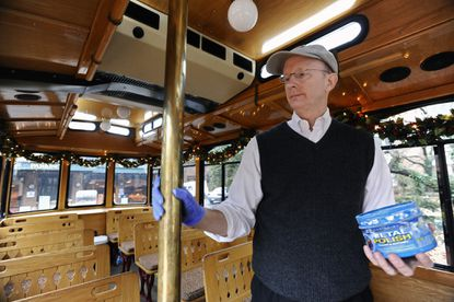 Discover Annapolis Tours owner Matt Grubbs, pictured polishing the trolley's interior, decided to discontinue the company's wedding trolley tour service, an icon in Annapolis' wedding scene, instead of being forced to serve same-sex couples because of passage of Question 6.