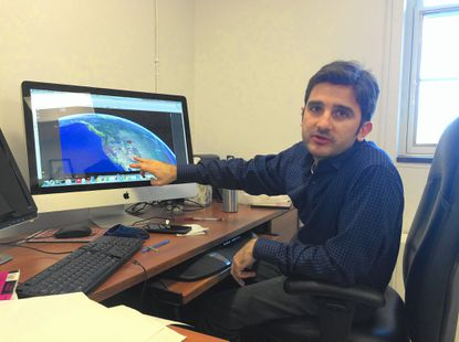 Assistant professor Vedran Lekic highlights a map of seismometers spread across the country.