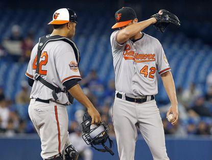 Orioles catcher Ronny Paulino talks to starting pitcher Brian Matusz. Matusz allowed five runs in 5 2/3 innings, taking the loss for the O's against he Blue Jays.
