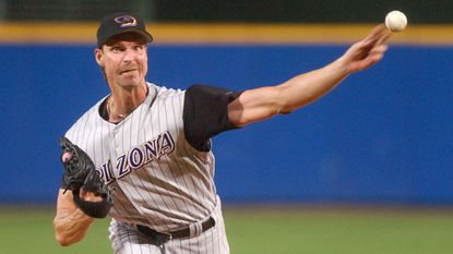 Left-hander Randy Johnson pitched for the Arizona Diamondbacks while Buck Showalter was the team's manager.