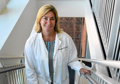 Dr. Leisha Emens at Johns Hopkins Kimmel Cancer Center. She is the leading researcher testing a blend of immune-targeting drugs in a trial of patients with triple negative breast cancer, a difficult form of breast cancer to treat.