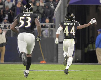 Baltimore Ravens defensive end Jihad Ward (53) follows cornerback Marlon Humphrey (44), who returns a New England Patriots fumble for a touchdown during the third quarter Nov. 3, 2019. Baltimore handed New England their first loss of the season with a 37-20 win.