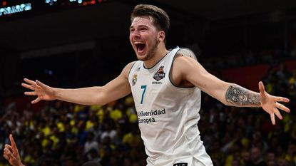 Real Madrid's Luka Doncic celebrates a 85-80 win over Fenerbahce in the Euroleague Final Four in Belgrade on May 20, 2018. Doncic was MVP of both the Euroleague season and its Final Four, the youngest player ever to win both honors.