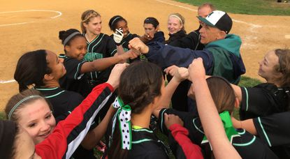 The Atholton softball team huddles up after defeating Hammond, 12-4, on Wednesday on the road.