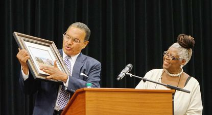 Dr. Freeman Hrabowski, III, president of UMBC and the keynote speaker at Hosanna School Museum's 150th anniversary banquet on Friday, takes a closer look at a print of Hosanna School Museum and McComas Institute he received from Sharoll Williams-Love, president of Hosanna's board of directors.