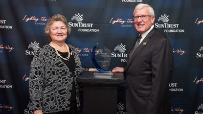 Maryland Council on Economic Education Executive Director Mary Ann Hewitt and board chairman Steve Arbaugh accept The SunTrust Foundation's Lighting the Way Award at a ceremony in October.