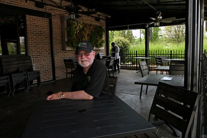 Randy Marriner, CEO of Victoria Restaurant Group, sits on the Terrace, Victoria Gastro Pub's outside dining area. Thirty people can be seated in the Terrace with social distancing. A tent will be set up in the parking lot to add 75 seats.