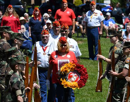 Gold Star Mother Gloria Crothers,front, leads members of the Marine Corps League, CPL Pete Arnold Detachment 1198 as they place a wreath during the Bel Air Memorial Day ceremony in Shamrock Park Monday, May 31, 2021.