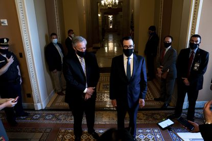 Treasury Secretary Steve Mnuchin, right, and Chief of Staff Mark Meadows, left, speak with reporters about a new economic rescue proposal, in Washington, July 23, 2020. Disputes over how to extend supplemental jobless benefits, and a White House push for money for a new FBI building, stalled the Republicans' rollout of their opening bid in negotiations with congressional Democrats over a new stimulus package.