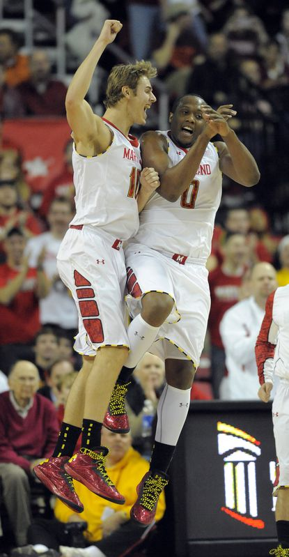 Terps forward Jake Layman, left, celebrates with teammate Charles Mitchell after Layman scored in the first half against Virginia Tech at Comcast Center.