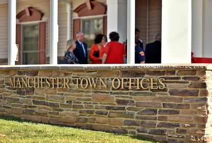 Town employees and residents gather for the dedication and ribbon-cutting ceremony for Manchester's new town hall and police station on Sunday, Oct. 30, 2016.