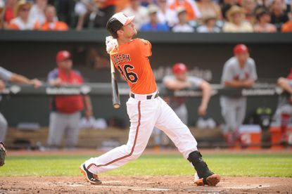 Caleb Joseph of the Baltimore Orioles hits a two-run home run in the second inning. Joseph has homered in five straight games in which he's played.