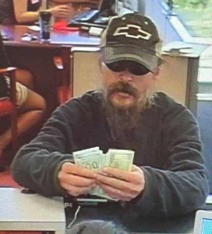 Authorities released this photograph taken from surveillance video of the suspect in the bank robbery in Glen Burnie.