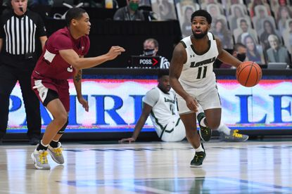 Loyola Maryland's Brandon Bradsher (11) dribbles while guarded by Lafayette's Tyrone Perry during a game Jan. 17, 2021, at Reitz Arena.