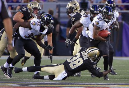 Ravensreturn manAsa Jackson (27) gains 10yards on a punt return, and is stopped by New Orleans Saints' Damian Swann (38) during a preseason exhibition game against theNew Orleans Saints at M&T Bank Stadium.