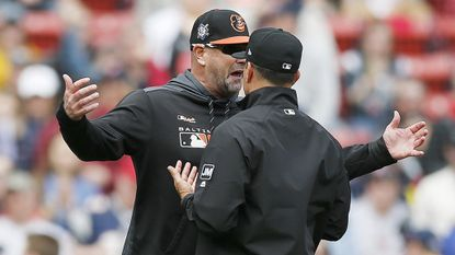 Orioles manager Brandon Hyde, left, argues with second base umpire Jim Reynolds after being ejected during the fifth inning against the Boston Red Sox in Boston on April 15, 2019.