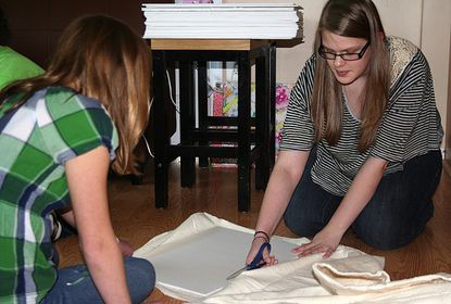 Carly Paratore, 14, and Carolie Milnes, 13, work together with their Girl Scout troop April 3 to create memory boards for residents at Copper Ridge. The memory boards are part of the Girl Scouts' Silver Award Project.