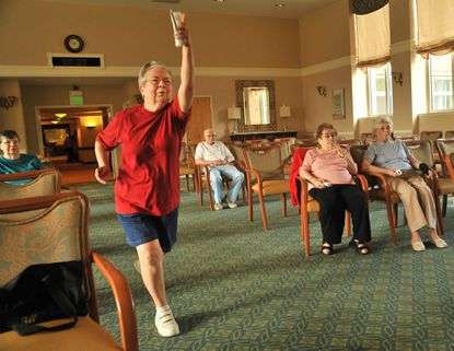 Carol Suplicki, 78, left, bowled her way to a score of 174 in the first day of the Wii Bowling Olympics at the North Oaks retirement community