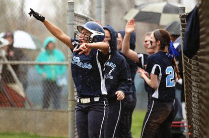 Howard's softball team cheers during a seven-run fifth inning on Friday against Mt. Hebron.