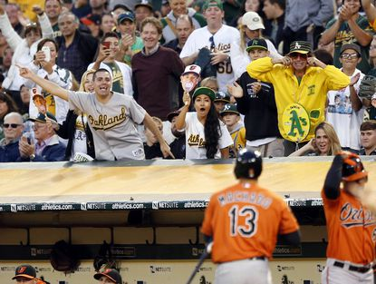 Oakland Athletics fans taunt Orioles third baseman Manny Machado after he struck out.