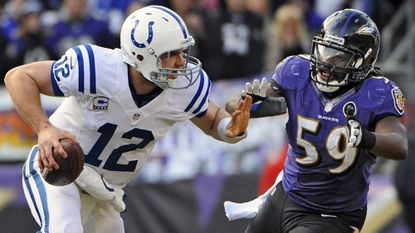 Ravens linebacker Dannell Ellerbe chases Colts quarterback Andrew Luck out of the pocket in the second quarter of a 2012 playoff game. The Ravens defeated the Indianapolis Colts, 24-9.