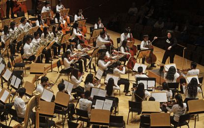 Gustavo Dudamel conducts a performance with Youth Orchestra Los Angeles at Walt Disney Concert Hall last May. Young musicians are the focus of the El Sistema program.