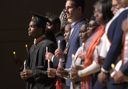 Representatives from Morgan State University and the surrounding neighborhoods stand together in unity as part of a reconciliation event during Morgan's Founders Day Convocation Thursday.
