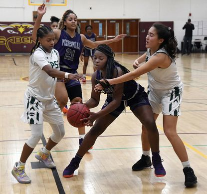 Pikesville's Frances Glover-Bey, center, tries to keep control of the ball as she's guarded by Saint Paul's Destiny Ryles, left, and Espirit Cha, right. Pikesville HS vs St. Paul's School for Girls basketball, played at the SEED school. December 27, 2019