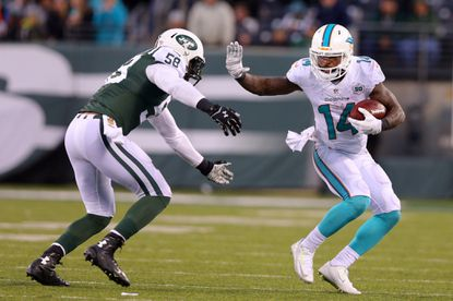 Jets linebacker Erin Henderson (Aberdeen, Maryland) pursues Dolphins wide receiver Jarvis Landry during a 2015 game.