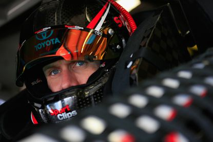 NASCAR driver Carl Edwards sits in his car during a practice for the Sprint Cup Series Sylvania 300 at New Hampshire Motor Speedway on Sept. 26.