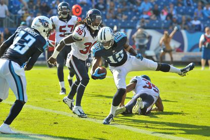 Tennessee Titans wide receiver Justin Hunter (15) scores a touchdown as Houston Texans strong safety D.J. Swearinger (36) and Houston defensive back Eddie Pleasant (35) defend during.