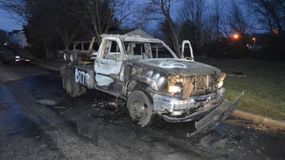 Investigators suspect arson is involved in a fire that destroyed a tow truck parked in Edgewood early Sunday.