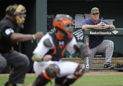 Boston Red Sox manager John Farrell, back right, is seen past home plate umpire Laz Diaz, left, and Baltimore Orioles catcher Caleb Joseph as he watches from the dugout in the ninth inning of a baseball game in Baltimore, Monday, May 30, 2016. (AP Photo/Patrick Semansky)
