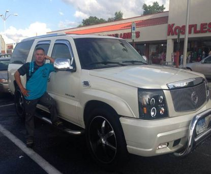 Juan Lux Quinilla is wanted in connection with a murder in Laurel, police say. He is posting with a 2006 Cadillac Escalade.