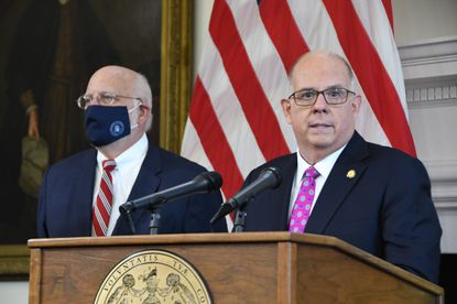 Dr. Robert Redfield, former CDC director under Donald Trump, is now an unpaid health adviser to Gov. Larry Hogan. Governor Hogan announced Tuesday he is lifting capacity limits at restaurants and opening up large indoor and outdoor venues at 50% capacity, while keeping in effect the state's mask mandate. (Bryn Stole/Baltimore Sun).