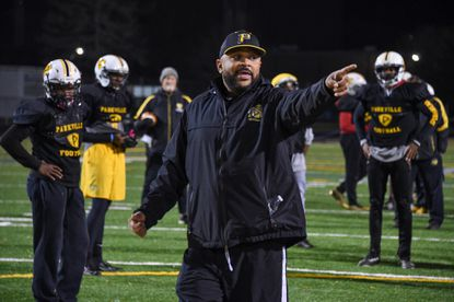 Head coach Justin Payne runs practice Thursday night. Parkville High School's undefeated football team runs a Navy triple-option offense coached by Justin Payne, who's been with the school for 5 years. Three running backs and and the team's quarterback all have 600+ yards this season. (Ulysses Muñoz, Baltimore Sun) 11-21-2019