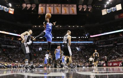 The Thunder's Russell Westbrook shoots the ball against the Spurs during the first half.