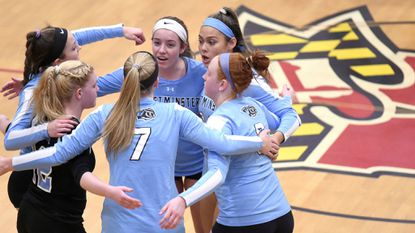 Westminster players celebrate against Towson during a Class 3A state semifinal match at University of Maryland's Ritchie Coliseum on Tuesday, Nov. 14.
