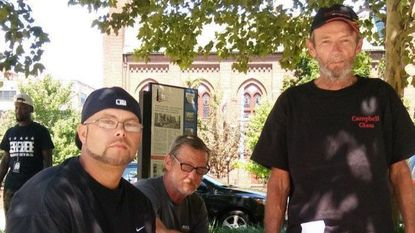 Russell Phillips, left, with two unidentified homeless men