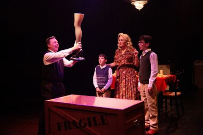 "Jeffrey Shankle, Patrick Ford, Heather Marie Beck and John Poncy perform during ""A Christmas Story"" at Toby's Dinner Theatre in Columbia."