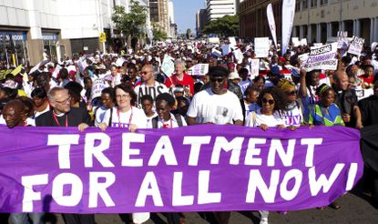 In this Monday, July 18, 2016 file photo, civil rights activists march at the start of the 21st World Aids Conference in Durban, South Africa. In 2019 fewer people in many parts of sub-Saharan Africa are dying of AIDS as treatment becomes more widely available, yet some officials worry that success may be encouraging a sense of complacency.