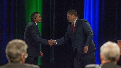 Rep. Ami Bera shakes hands with his Republican challenger, Sacramento County Sheriff Scott Jones.