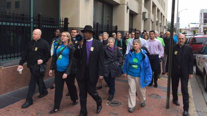 About 50 immigration advocates and clergy marched Thursday on U.S. Immigration and Customs Enforcement's Baltimore office to demand a meeting about recent detentions of undocumented immigrants.