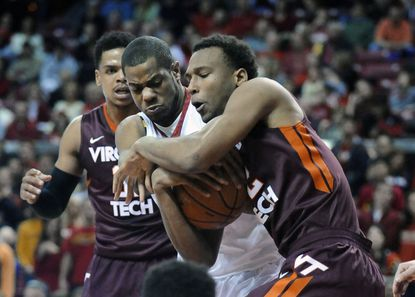 Maryland's Damonte Dodd battles Virginia Tech's Trevor Thompson for the ball in a game in March.